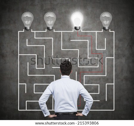Confused businessman brainstorming the labyrinth to find the solution  - stock photo