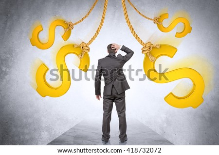 Confused businessman looking on dollar signs and thinking - stock photo