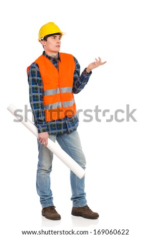 Confused construction worker in yellow helmet and orange waistcoat. Three quarter length studio shot isolated on white.