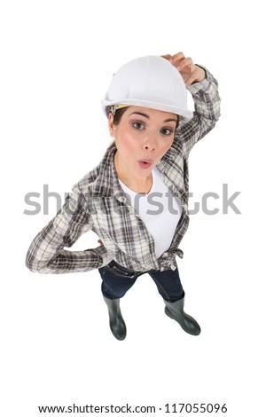 Confused female construction worker - stock photo