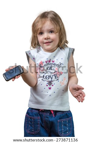 confused little girl with a small black phone in hand - stock photo