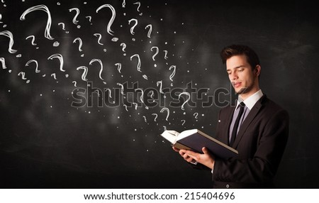 Confused man reading a book with question marks coming out from it - stock photo