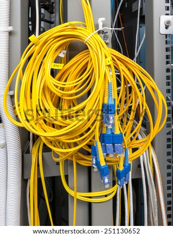 Confused of fiber optic in server room - stock photo