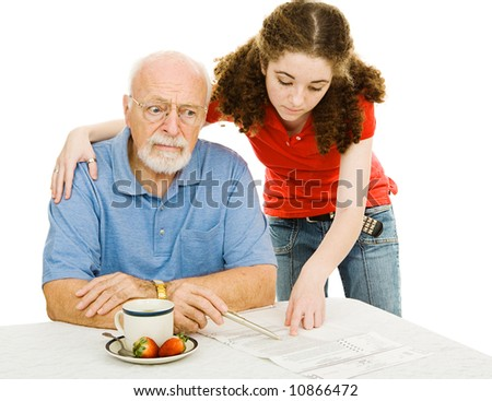 Confused senior man trying to fill out an absentee ballot with his granddaughter's help.  Isolated on white. - stock photo