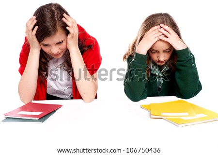 Confused students holding their heads and looking down - stock photo