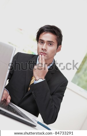 Confused unhappy office worker - stock photo