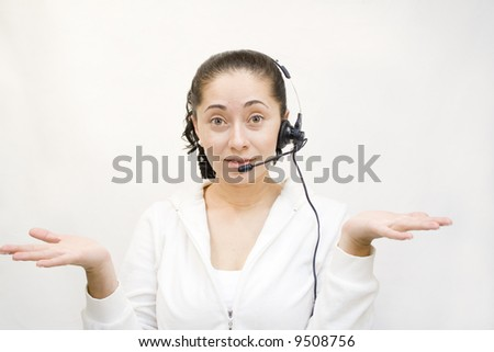 Confused woman with service headset on phone - stock photo