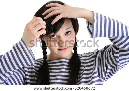 confused young brunette woman, touching her hair, isolated on white