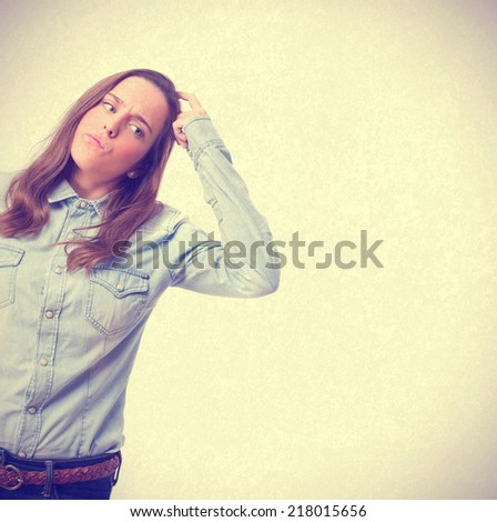 confused young girl - stock photo