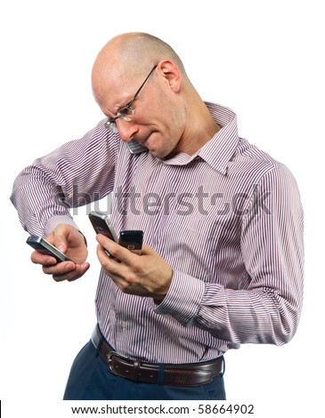 Confused young man with many phones - stock photo