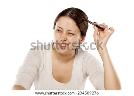 confused young woman scratching her head with pen - stock photo