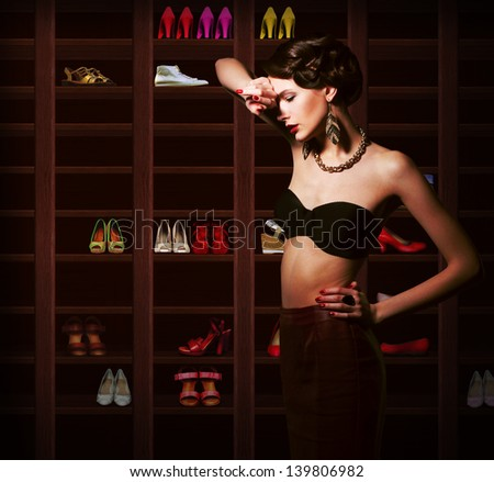 Confusion. Upset Woman Choosing what to Wear. Wardrobe with Footwear - stock photo