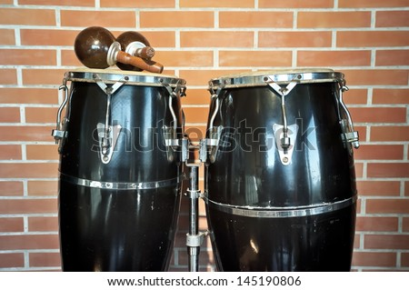 Congas and maracas. Congas and maracas in front of a brick wall - stock photo