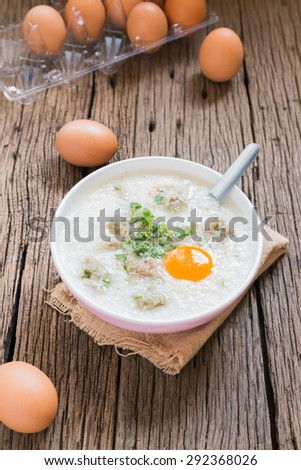 "congee, rice gruel ""Khao Tom Moo"" mixed with pork and eggs"
