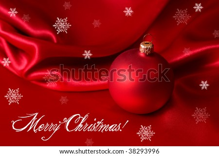 congratulation card with red ornament on the satin