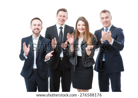 Congratulations! Group of happy business people in formal wear applauding and smiling. Isolated on white.