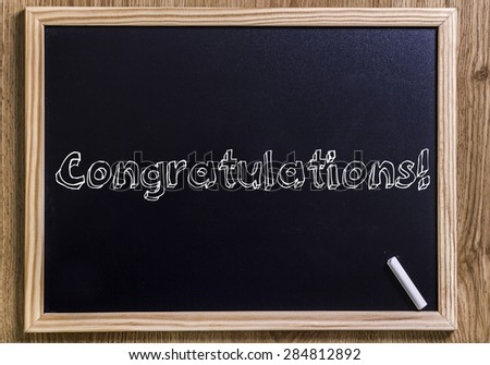 Congratulations - New chalkboard with 3D outlined text - on wood - stock photo