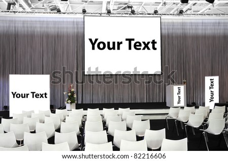 Congress hall with empty screens for Your Text - stock photo