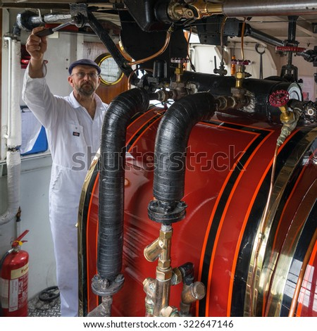 CONISTON WATER, LAKE DISTRICT/ENGLAND - AUGUST 21 : Boiler Room of the Steam Yacht Gondola on Coniston Water in the Lake District England on August 21, 2015. Unidentified man.