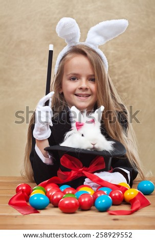 Conjuring the easter rabbit - young magician perform a seasonal trick - stock photo
