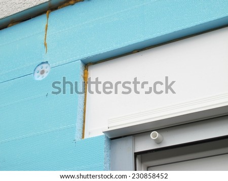 Connecting a thermal insulation to a roller shutter box - stock photo