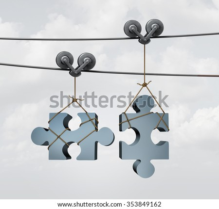 Connecting puzzle pieces as a merger or merging business concept with two jigsaw objects on two guidance cable wires or zip liner tool aligning and coming together as a partnership. - stock photo