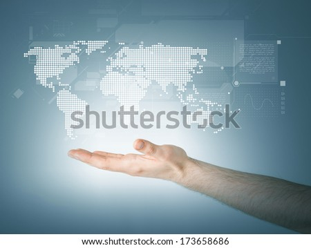 connection and future technology concept - closeup of mans hand showing world map