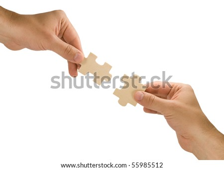 connection concept.  hands with pieces of puzzle on white background - stock photo