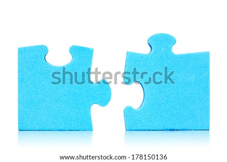 Connection metaphor. Two  pieces of blue puzzle on white background  - stock photo