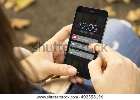 connectivity concept: woman holding a 3d generated smartphone with notifications on the screen. Graphics on screen are made up. - stock photo