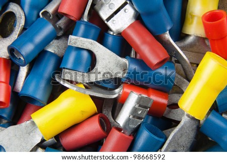 connectors for the electrical installation in cars with colored tips - stock photo