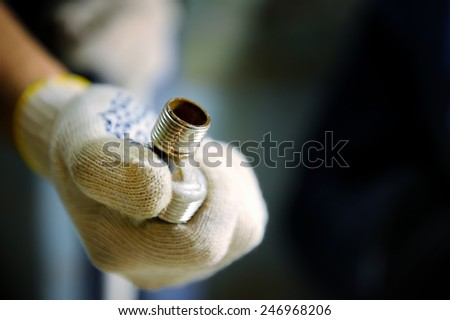 Connectors of plumbing pipes in the hand - stock photo
