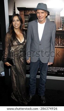 Connie Angland and Billy Bob Thornton at the Los Angeles premiere of 'The Judge' held at the AMPAS Samuel Goldwyn Theater in Los Angeles on October 1, 2014. - stock photo