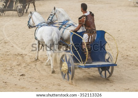 Conquest, Roman chariots in the circus arena, fighting warriors and horses - stock photo