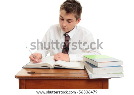 Conscientious high school student at desk with study books. - stock photo