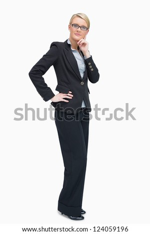 Considering businesswoman standing with her hand on the hip - stock photo