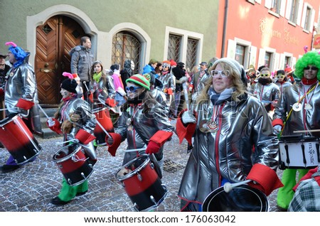 CONSTANCE, GERMANY - FEBRUARY 10 2013: The band of drummers march in the street at the winter carnival Fastnacht in CONSTANCE, GERMANY - FEBRUARY 10 2013.