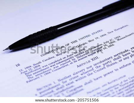 Constitution of the United States close up with a pen - stock photo