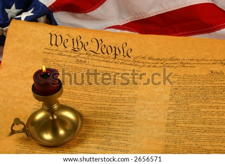 Constitution of the USA with candle and flag - stock photo