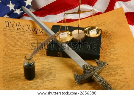"""Constitution, Sword, Bible, inkwell, quill pen, and Scales weighing """"mercy"""" and """"wrath"""" - stock photo"""