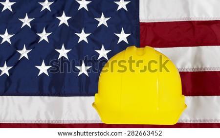 Construcion Industry Helmet on American Made Flag - stock photo