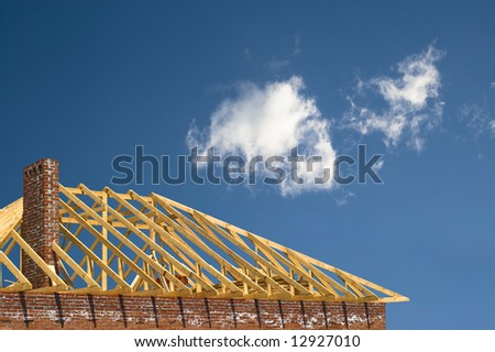 constructing of the roof on the sky - stock photo
