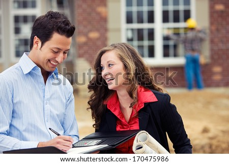 Construction: Architect And Real Estate Agent In Discussion. - stock photo