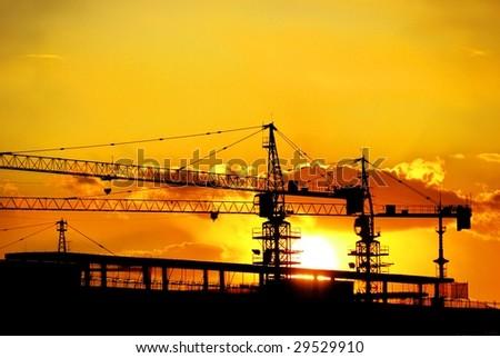 Construction at Sunset. - stock photo