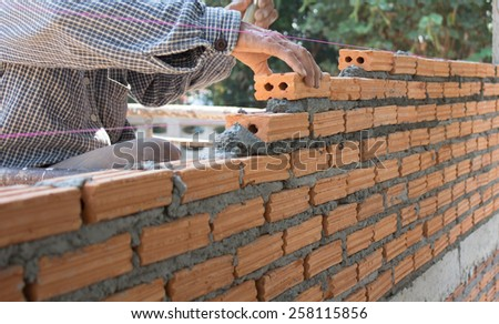 Construction bricklayer worker - stock photo