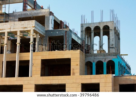 Construction building in front of blue sky - stock photo