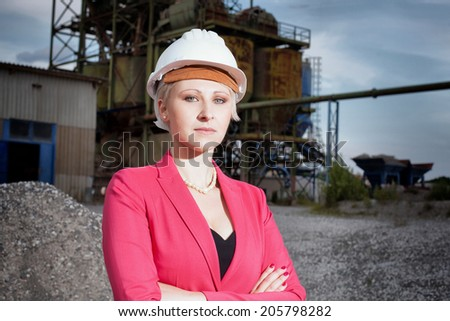Construction business woman on working field - stock photo