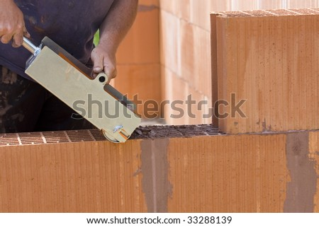 construction by red bricks with tools