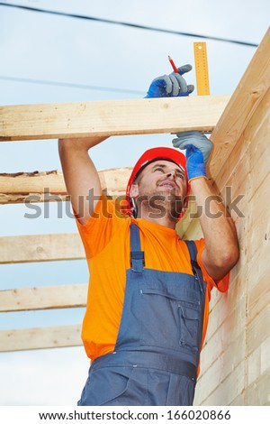 construction carpenter worker measuring wood board with angle on roof installation work