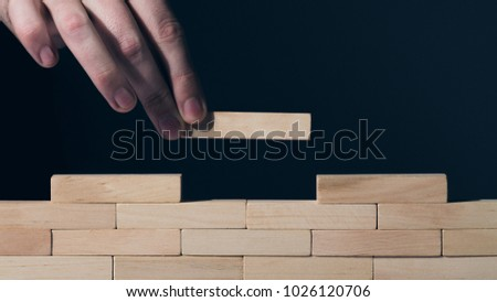 Construction concept Wooden puzzles